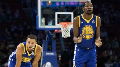 Nov 18, 2017; Philadelphia, PA, USA; Golden State Warriors guard Stephen Curry (30) and forward Kevin Durant (35) watch on during foul shots against the Philadelphia 76ers during the fourth quarter at Wells Fargo Center. Mandatory Credit: Bill Streicher-USA TODAY Sports