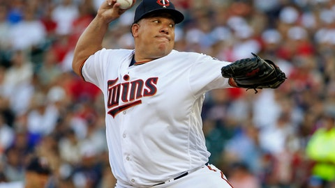 Minnesota Twins starting pitcher Bartolo Colon throws to the New York Yankees in the first inning of a baseball game Tuesday, July 18, 2017, in Minneapolis. (AP Photo/Bruce Kluckhohn)