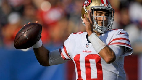 San Francisco 49ers quarterback Jimmy Garoppolo passes against the Los Angeles Rams during the first half of an NFL football game, Sunday, Dec. 31, 2017, in Los Angeles. (AP Photo/Mark J. Terrill)