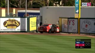 Car gets stuck in right field during Astros-Cardinals spring training game
