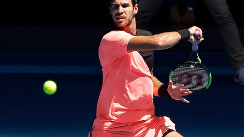 Russia's Karen Khachanov makes a forehand return to Argentina's Juan Martin del Potro during their second round match at the Australian Open tennis championships in Melbourne, Australia, Thursday, Jan. 18, 2018. (AP Photo/Dita Alangkara)