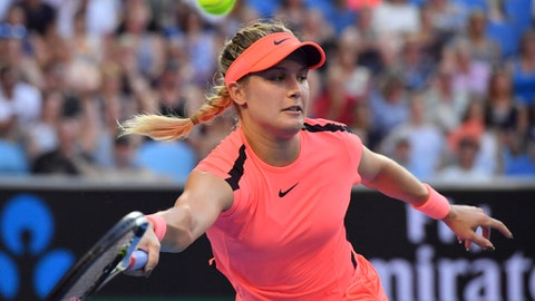 Canada's Eugenie Bouchard reaches for a return to Romania's Simona Halep during their second round match at the Australian Open tennis championships in Melbourne, Australia, Thursday, Jan. 18, 2018. (AP Photo/Andy Brownbill)