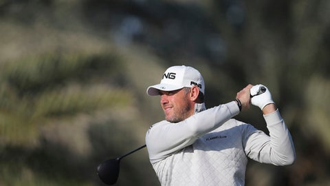 England's Lee Westwood tees off on the 14th hole during the second round of the Abu Dhabi Championship golf tournament in Abu Dhabi, United Arab Emirates, Friday, Jan. 19, 2018. (AP Photo/Kamran Jebreili)