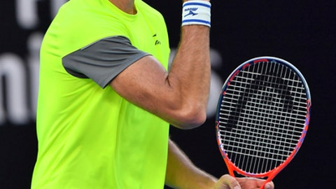 Croatia's Ivo Karlovic reacts after winning the fourth set against Italy's Andreas Seppi during their third round match at the Australian Open tennis championships in Melbourne, Australia, Friday, Jan. 19, 2018. (AP Photo/Andy Brownbill)