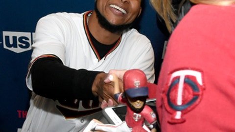 Minnesota Twins' Ervin Santana greets a person attending the baseball team's TwinsFest on Friday, Jan. 19, 2018, in Minneapolis. (AP Photo/Hannah Foslien)