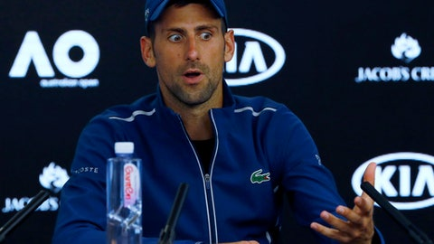 Serbia's Novak Djokovic gestures at a press conference following his fourth round loss to South Korea's Chung Hyeon at the Australian Open tennis championships in Melbourne, Australia, Monday, Jan. 22, 2018. (AP Photo/Ng Han Guan)