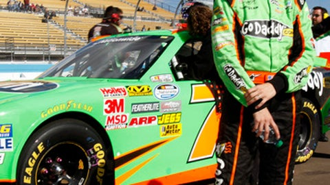 FILE - In this Nov. 10, 2012, file photo, driver Danica Patrick looks toward a scoreboard after qualifying for the NASCAR Nationwide Series auto race, at Phoenix International Raceway in Avondale, Ariz. Patrick is teaming with Premium Motorsports for next month's Daytona 500, the final race of her NASCAR career. The one-race deal will put Patrick in the seat of the No. 7 GoDaddy Chevrolet, the same car number she drove when she entered stock-car racing in 2010.(AP Photo/Paul Connors, File)