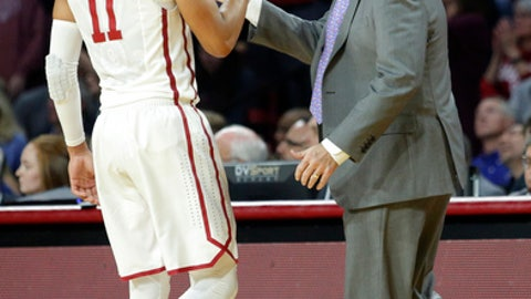 Oklahoma head coach Lon Kruger high-fives Trae Young (11) during the first half of an NCAA college basketball game in Norman, Okla., Tuesday, Jan. 23, 2018. (AP Photo/Garett Fisbeck)