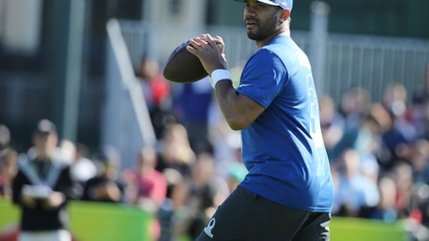NFC quarterback Russell Wilson, of the Seattle Seahawks, prepares to throw a pass during Pro Bowl NFL football practice, Wednesday, Jan. 24, 2018, in Kissimmee, Fla. (AP Photo/Gregory Payan)