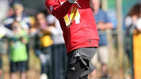 AFC wide receiver Jarvis Landry, of the Miami Dolphins, catches a pass during Pro Bowl NFL football practice, Wednesday, Jan. 24, 2018 in Kissimmee, Fla. (AP Photo/Doug Benc)