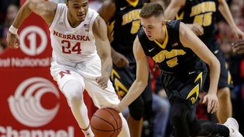 Iowa's Jordan Bohannon (3) and Nebraska's James Palmer Jr. (24) chase the ball during the second half of an NCAA college basketball game in Lincoln, Neb., Saturday, Jan. 27, 2018. Nebraska won 98-84. (AP Photo/Nati Harnik)