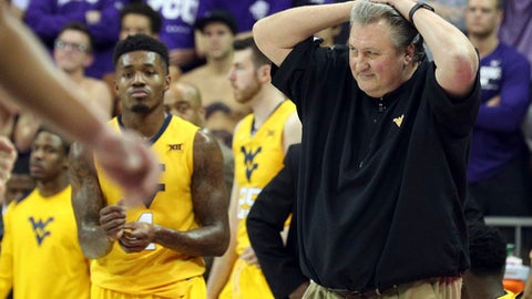 FILE - In this Monday, Jan. 22, 2018, file photo, West Virginia head coach Bob Huggins reacts during an NCAA college basketball game against TCU in Fort Worth, Texas. Over the past three weeks, West Virginia went from the nation's longest winning streak to its worst slump in four years. The Mountaineers have lost four of their last five games, including surrendering double-digit leads in the second half in losses to No. 10 Texas Tech, No. 7 Kansas and No. 21 Kentucky.  (AP Photo/Richard W. Rodriguez, File)