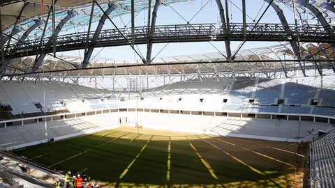 "FILE  - In this Wednesday, Sept. 20, 2017 file photo, a view on the pitch of the World Cup stadium which is still under construction in Volgograd, Russia. The Russian government says a plague of locusts could ""disgrace"" the country by destroying World Cup fields, it was reported on Wednesday, Jan. 31, 2018, Locusts often feast on crops in southern Russia and a member of the agriculture ministry says they could descend on stadiums. (AP Photo, File)"