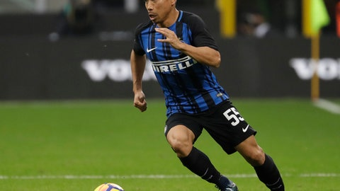 In this photo taken on Sunday, Nov. 5, 2017, Inter Milan's Yuto Nagatomo controls the ball during a Serie A soccer match between Inter Milan and Torino, at the San Siro stadium in Milan, Italy. On a relatively quiet transfer deadline day in Italy, the bigger news was the players leaving the country. Brazilian defender Emerson Palmieri moved to Chelsea from Roma in a deal worth up to 29 million euros while Japan and Inter Milan defender Yuto Nagatomo joined Galatasaray on loan until the end of the season. Roma immediately replaced Emerson with Argentina left back Jonathan Silva, who joined on loan from Sporting Lisbon until the end of the season with the Giallorossi having the option to make the deal permanent. (AP Photo/Luca Bruno)