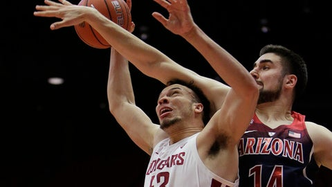 Washington State forward Drick Bernstine (43) is fouled on the way to the basket by Arizona center Dusan Ristic (14) during the first half of an NCAA college basketball game in Pullman, Wash., Wednesday, Jan. 31, 2018. (AP Photo/Young Kwak)