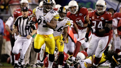 FILE - In this Feb. 1, 2009, file photo, Pittsburgh Steelers linebacker James Harrison (92) returns the ball 100 yards for a touchdown after an interception in the second quarter against the Arizona Cardinals in the NFL football Super Bowl 43 in Tampa, Fla. Pursuing is Cardinals guard Reggie Wells (74). Arizona appeared set to take the lead in the closing seconds of the first half when Harrison stepped in front of Anquan Boldin and intercepted a pass at the goal line on the final play of the half to put Pittsburgh up 17-7. (AP Photo/Mark Humphrey, File)