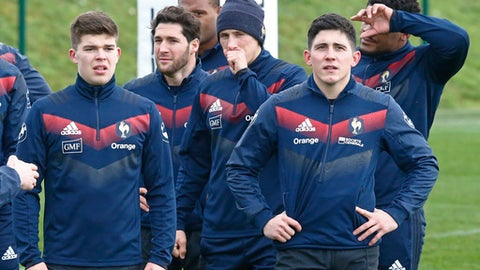 From left to right, French rugby players Matthieu Jalibert, Maxime Machenaud, Batiste Serin and Anthony Belleau attend a training session at the National Rugby Center in Marcoussis, south of Paris, France, Thursday, Feb. 1, 2018. France will face Ireland during their Six Nations tournament match at Stade de France stadium on Saturday Feb. 3, 2018. (AP Photo/Michel Euler)