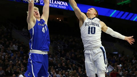 Creighton center Jacob Epperson (41) attempts a dunk as Villanova guard Donte DiVincenzo (10) defends during the first half of an NCAA college basketball game in Philadelphia, Thursday, Feb. 1, 2018. (AP Photo/Rich Schultz)
