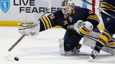 Buffalo Sabres goalie Chad Johnson (31) makes a save during the second period of an NHL hockey game against the Florida Panthers, Thursday, Feb. 1, 2018, in Buffalo, N.Y. (AP Photo/Jeffrey T. Barnes)