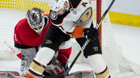 Anaheim Ducks center Ryan Kesler tries to deflect a shot past Ottawa Senators goaltender Mike Condon during the second period of an NHL hockey game Thursday, Feb. 1, 2018, in Ottawa, Ontario. (Adrian Wyld/The Canadian Press via AP)