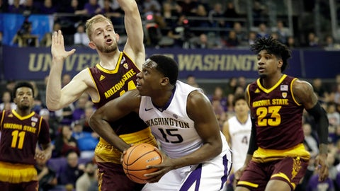 Washington forward Noah Dickerson (15) tries to put up a shot against the defense of Arizona State guard Kodi Justice as Arizona State forward Romello White (23) looks on in the first half of an NCAA college basketball game, Thursday, Feb. 1, 2018, in Seattle. (AP Photo/Ted S. Warren)