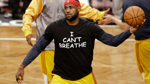 "FILE - In this Dec. 8, 2014 file photo, Cleveland Cavaliers' LeBron James wears a T-shirt reading ""I Can't Breathe,"" protesting the death of Eric Garner, during warms up before an NBA basketball game against the Brooklyn Nets in New York. Despite their vastly divergent methods, Colin Kaepernick and LeBron James helped set a stake in the ground, declaring to athletes across all sports that their platforms could be used for more than fun and games in the 21st century. (AP Photo/Frank Franklin II, File)"