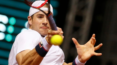 United States' John Isner returns the ball to Serbia's Dusan Lajovic during their Davis Cup World group first round tennis match in Nis, Serbia, Friday, Feb. 2, 2018. (AP Photo/Darko Vojinovic)