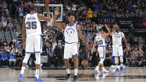 SACRAMENTO, CA - FEBRUARY 2: Kevin Durant #35 and Nick Young #6 of the Golden State Warriors exchange high fives during the game against the Sacramento Kings on February 2, 2018 at Golden 1 Center in Sacramento, California. (Photo by Rocky Widner/NBAE via Getty Images)