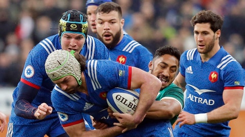France's Kevin Gourdon is tackled by Ireland's Bundee Aki, right, during the Six Nations rugby union match between France and Ireland at the Stade de France stadium in Saint-Denis, outside Paris, France, Saturday, Feb. 3, 2018. (AP Photo/Michel Euler)