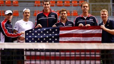United States' coach Robby Ginepry, players Steve Johnson, John Isner, Ryan Harrison, Sam Querrey and team captain Jim Courier, from left to right, pose after winning the first three tennis matches of their Davis Cup World Group first round challenge in Nis, Serbia, Saturday, Feb. 3, 2018. (AP Photo/Darko Vojinovic)