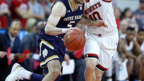 North Carolina State's Braxton Beverly (10) defends as Notre Dame's Matt Farrell (5) dribbles during the first half of an NCAA college basketball game at PNC Arena in Raleigh, N.C., Saturday, Feb. 3, 2018. (Ethan Hyman/The News & Observer via AP)
