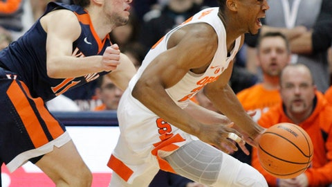 Virginia's Ty Jerome, left, put pressure on Syracuse's Tyus Battle, right, in the first half an NCAA college basketball game in Syracuse, N.Y., Saturday, Feb. 3, 2018. (AP Photo/Nick Lisi)