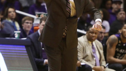 Kansas State head coach Bruce Weber talks to his players during the first half of an NCAA college basketball game against West Virginia, Saturday, Feb. 3, 2018, in Morgantown, W.Va. (AP Photo/Raymond Thompson)