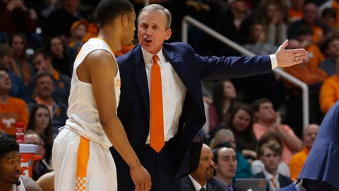 Tennessee head coach Rick Barnes talks with Tennessee guard James Daniel III, left, in the first half of an NCAA college basketball game against Mississippi on Saturday, Feb. 3, 2018, in Knoxville, Tenn. (AP Photo/Crystal LoGiudice)