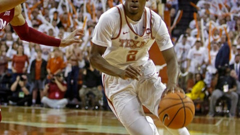 Texas guard Matt Coleman (2) drives the ball against Oklahoma guard Trae Young during the second half of an NCAA college basketball game, Saturday, Feb. 3, 2018, in Austin, Texas. (AP Photo/Michael Thomas)