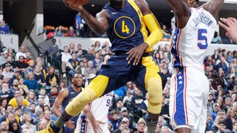 INDIANAPOLIS, IN - FEBRUARY 03: Victor Oladipo #4 of the Indiana Pacers looks to pass the ball after driving under the basket against the Philadelphia 76ers in the first half of a game at Bankers Life Fieldhouse on February 3, 2018 in Indianapolis, Indiana. (Photo by Joe Robbins/Getty Images)