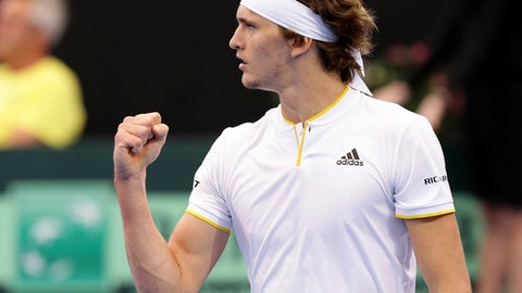 Alexander Zverev of Germany reacts after winning a point in his match against Nick Kyrgios of Australia at the Davis Cup World Group first round in Brisbane, Australia, Sunday, Feb. 4, 2018. (AP Photo/Tertius Pickard)
