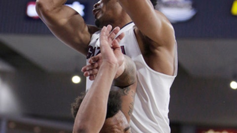 Gonzaga forward Johnathan Williams, top, grabs a rebound over BYU guard Jahshire Hardnett during the first half of an NCAA college basketball game in Spokane, Wash., Saturday, Feb. 3, 2018. (AP Photo/Young Kwak)