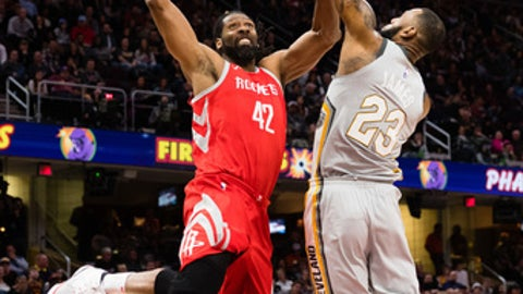 CLEVELAND, OH - FEBRUARY 3: Nene Hilario #42 of the Houston Rockets dunks over LeBron James #23 of the Cleveland Cavaliers during the first half at Quicken Loans Arena on February 3, 2018 in Cleveland, Ohio. (Photo by Jason Miller/Getty Images)
