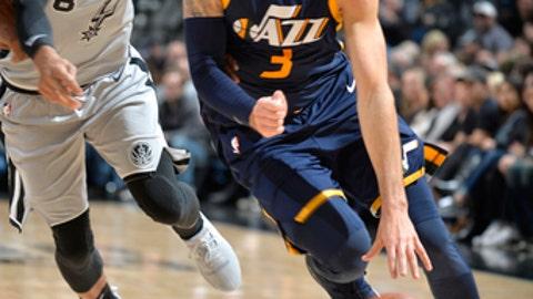 SAN ANTONIO, TX - FEBRUARY 3:  Ricky Rubio #3 of the Utah Jazz handles the ball against Patty Mills #8 of the San Antonio Spurs on February 3, 2018 at the AT&T Center in San Antonio, Texas.