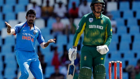India's bowler Jasprit Bumrah, left, reacts after his delivery against South Africa's batsman Quinton de Kock during the second One Day International cricket match between South Africa and India at Centurion Park in Pretoria, South Africa, Sunday, Feb. 4, 2018. (AP Photo/Themba Hadebe)