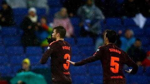 FC Barcelona's Gerard Pique, left, celebrates after scoring during the Spanish La Liga soccer match between Espanyol and FC Barcelona at RCDE stadium in Cornella Llobregat, Spain, Sunday, Feb. 4, 2018. (AP Photo/Manu Fernandez)
