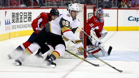 Vegas Golden Knights right wing Alex Tuch (89) skates with the puck as Washington Capitals defenseman Christian Djoos (29), from Sweden, and goaltender Philipp Grubauer (31), watch during the first period of an NHL hockey game, Sunday, Feb. 4, 2018, in Washington. (AP Photo/Alex Brandon)