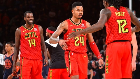NEW YORK, NY - FEBRUARY  4:  Kent Bazemore #24 of the Atlanta Hawks reacts with Taurean Prince #12 of the Atlanta Hawks during the game against the New York Knicks on February 4, 2018 in New York City, New York at Madison Square Garden (Photo by Jesse D. Garrabrant/NBAE via Getty Images)