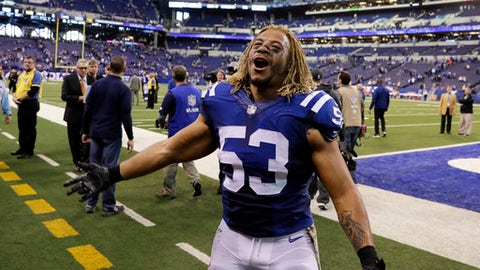"FILE - In this Nov. 20, 2016 file photo, Indianapolis Colts linebacker Edwin Jackson (53) walks off the field following an NFL football game against the Tennessee Titans in Indianapolis. Jackson, 26, was one of two men killed when a suspected drunken driver struck them as they stood outside their car along a highway in Indianapolis. The Colts said in a statement Sunday, Feb. 4, 3018, that the team is ""heartbroken"" by Jackson's death. Authorities say the driver that struck them before dawn on Sunday tried to flee on foot but was quickly captured.  (AP Photo/Darron Cummings, File)"