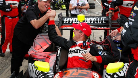 "File- This June 4, 2016, file photo shows Sebastien Bourdais, of France, right, celebrating with team co-owner Jimmy Vassar winning race one of the IndyCar Detroit Grand Prix auto racing double header on Belle Isle in Detroit. Vasser has returned to IndyCar after a one-year absence in a partnership with Dale Coyne Racing. Vasser and business partner James ""Sulli"" Sullivan merged with Coyne to create Dale Coyne Racing with Vasser-Sullivan for this season. Vasser and Sullivan will be re-united with driver Sebastien Bourdais, who spent three seasons driving for them under KVSH Racing. (AP Photo/Paul Sancya, File)"