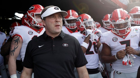 FILE - In this Jan. 1, 2018, file photo, Georgia head coach Kirby Smart waits with his team to run onto the field before the Rose Bowl NCAA college football game against Oklahoma in Pasadena, Calif. There's a strange sense of calm that has replaced the tumult typically associated with this time of year on the college football recruiting calendar. The December signing period has removed much of the suspense from the traditional national signing day that takes place the first Wednesday of February. Most of the top high school prospects already signed in December. (AP Photo/Jae C. Hong, File)