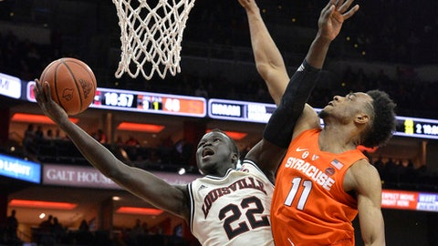 Louisville forward Deng Adel (22) screens off Syracuse forward Oshae Brissett (11) as he attempts a layup during the second half of an NCAA college basketball game, Monday, Feb. 5, 2018, in Louisville, Ky. Syracuse won 78-73. (AP Photo/Timothy D. Easley)