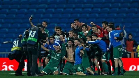 FILE - In this Jan. 24, 2018 file photo, Leganes' players celebrate their victory against Real Madrid at the end of the Spanish Copa del Rey quarterfinal second leg soccer match at the Santiago Bernabeu stadium in Madrid, Spain. The team everyone is talking about now is Leganes, the modest club based just south of the capital. It spent a decade in the third tier, from 2004-2014, before making the run that took the club to the first division in 2016. (AP Photo/Francisco Seco, File)