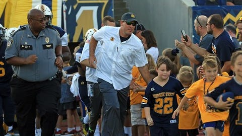 """<p>(STATS) - Year four of the Mitch Stewart era at Murray State features perhaps the most difficult start, but the Racers hope the early games lead to improvement in the Ohio Valley Conference.</p><p>Murray State will kick off the season by hosting old rival Southern Illinois on Aug. 30 and then travel to 2017 Southland Conference champ Central Arkansas on Sept. 8 and SEC member Kentucky Sept. 15.</p><p>""""Needless to say, our first three weeks should give us a good idea of where we are at as a football team before starting conference play,"""" said Stewart, whose program has a 10-23 record in his three seasons and went 3-8 in 2017. """"It's a tough schedule, but it's one that we are looking forward to playing.""""</p><p>The Racers will play half of their eight OVC opponents at home - UT Martin (Sept. 29), Tennessee State (Oct. 13), defending champ Jacksonville State (Oct. 27) and Southeast Missouri (Nov. 10).</p><p>2018 Murray State schedule</p><p>Aug. 30, Southern Illinois</p><p>Sept. 8, at Central Arkansas</p><p>Sept. 15, at Kentucky</p><p>Sept. 29, UT Martin*</p><p>Oct. 6, at Eastern Illinois*</p><p>Oct. 13, Tennessee State*</p><p>Oct. 20, at Eastern Kentucky*</p><p>Oct. 27, Jacksonville State*</p><p>Nov. 3, at Tennessee Tech*</p><p>Nov. 10, Southeast Missouri*</p><p>Nov. 17, at Austin Peay*</p><p>* - OVC game</p>"""